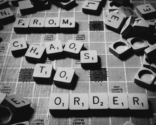 "Letter gameboard that reads ""from chaos to order"""