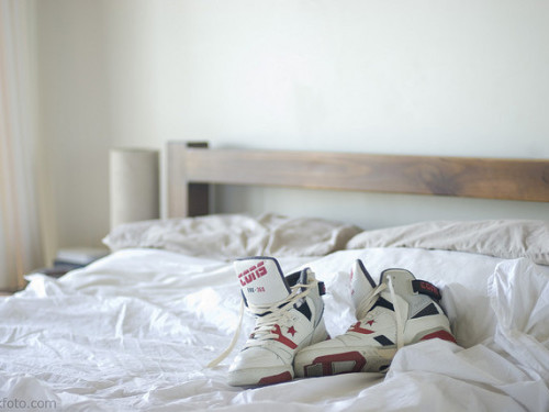 Photo of shoes on an unmade bed