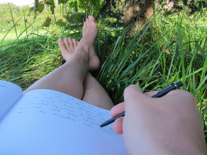 person-writing-outside